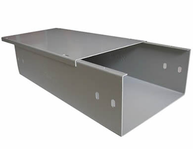 A gray channel cable tray with a cover supports cables