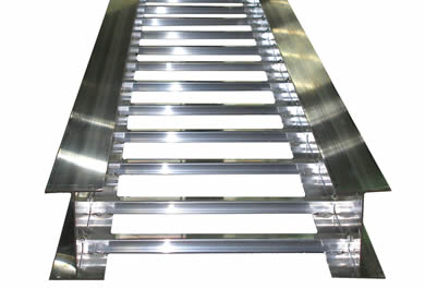 An aluminum ladder cable tray with I-beam channels and rungs